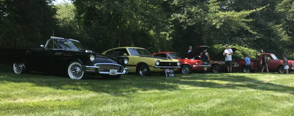 This row of classics that settled in under the far tree line included some pretty cool Fords.  Among them, a super-low 10,000 mile yellow 1970 Maverick.