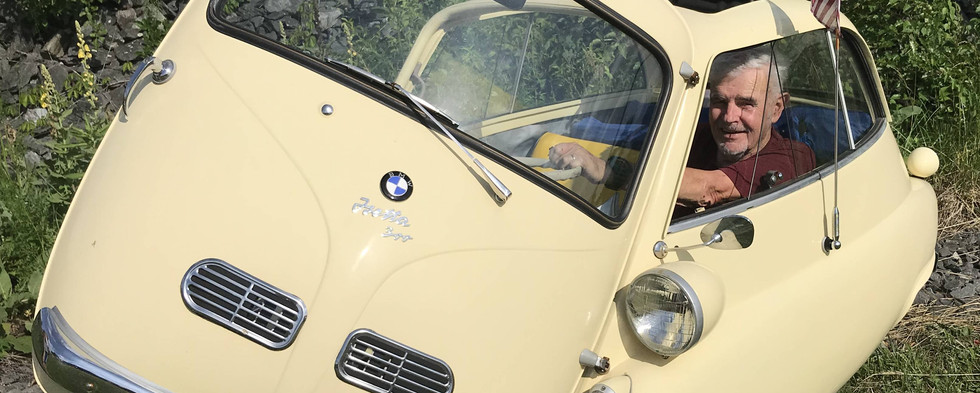 Yes, the entire front of the car served as a door...to which the steering wheel was attahced...on the BMW Iseta.  This particular example was a 1957.
