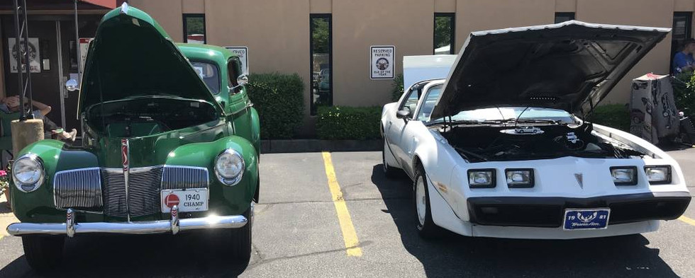 On the left...Dennis D's 1940 Studebaker in eat-your-vegetables green...and that's Artie V's hot Trans Am right next to it.
