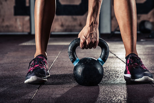 Weight lifting with kettle bell at dur1 health fitness