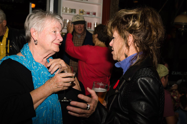 A photo of Sally and a woman talking at Sally's Peterborough book reading.