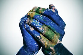 a world map in man hands forming a globe