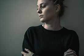 Portrait of young sad woman with anxiety
