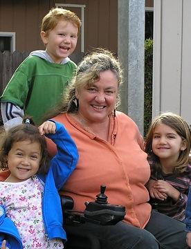 Lauren_with_3_kids.jpg