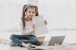 girl-attending-virtual-classes-holding-d