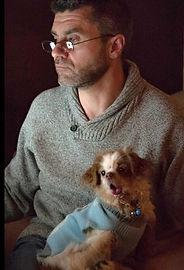 Tiny dog with man