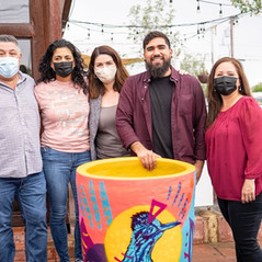 At the ribbon cutting ceremony on July 29th to unveil the painting planters created by students in the 2021 TABY Youth Art project. They will decorate La Doce!