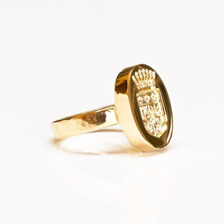 """It took two years and a close cooperation with two sisters to come down with Anna Moltke-Huitfeldt's special signet ring design.  The ring is both a carrier of the family coat of arms and an elegante piece of jewellery that you can wear everyday, and it mixes well with your other jewellery pieces.  """"To add air to the ring, in more than one respect, the signet plate is supported by the ring below rather than a part of it, making it flow slightly above your finger, giving it that extra touch of lightness, that signifies many of my designs"""", says Anna Moltke-Huitfeldt  Made to order with your personal initials or family coat of arms."""