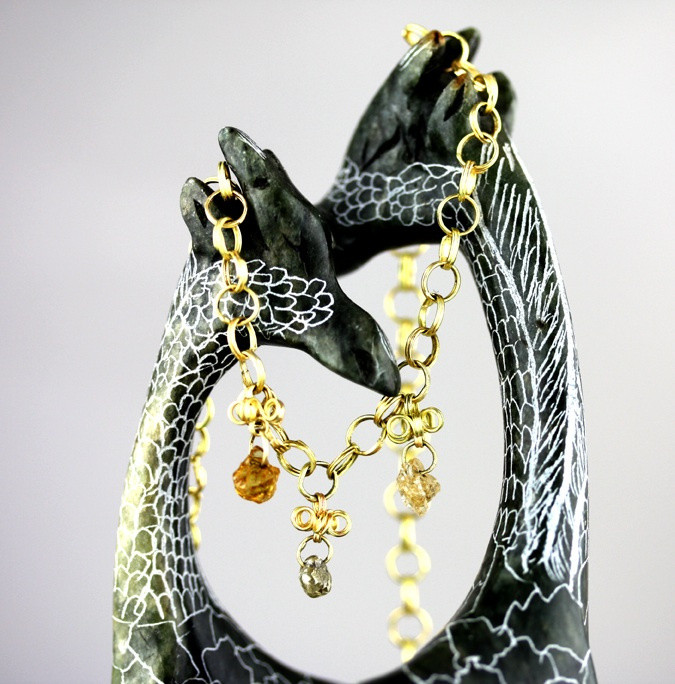 Gold spiral necklace with rough diamonds