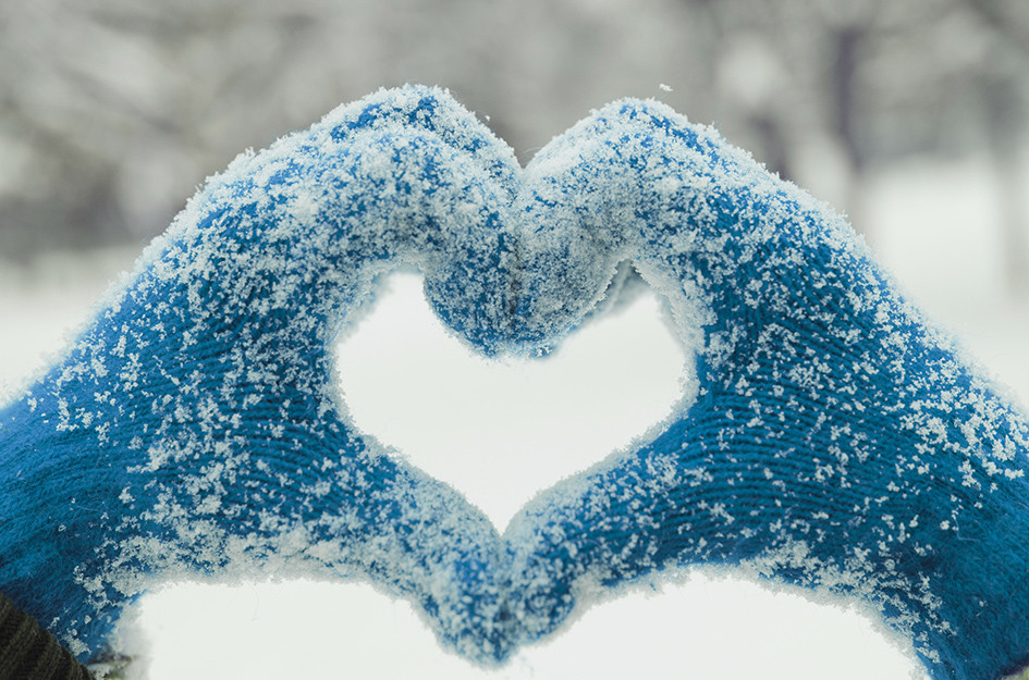 snow covered mittens shaped like heart