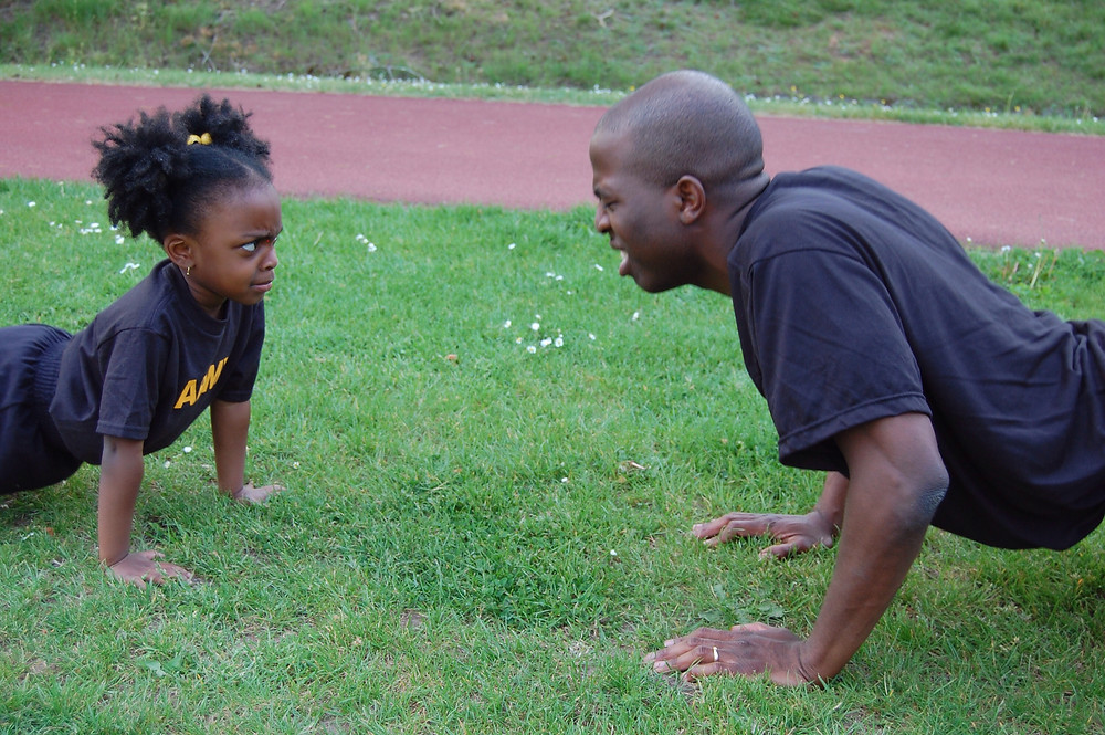 dad and daughter doing pushups