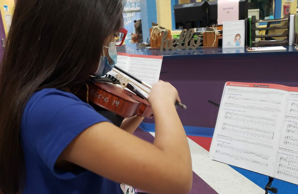 Member practices violin