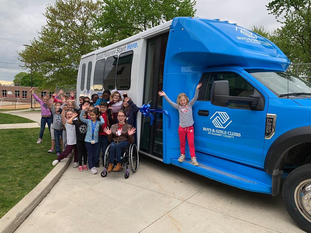 Kids beside new bus