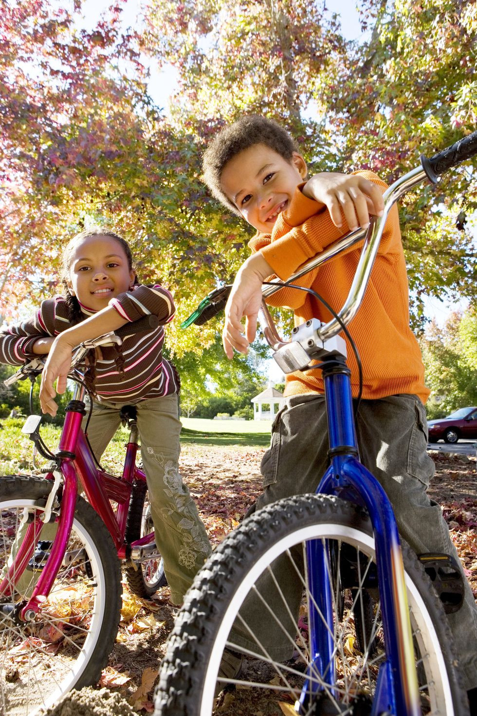 smiling-children-riding-bikes-in-autumn-park-at-royalty-free-image-1603380294.jpg
