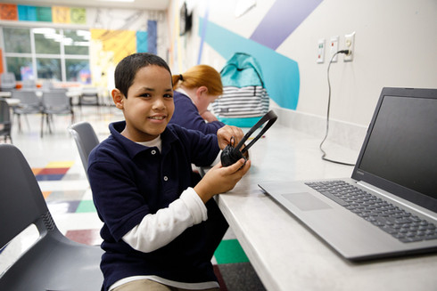 child using headphones and computer