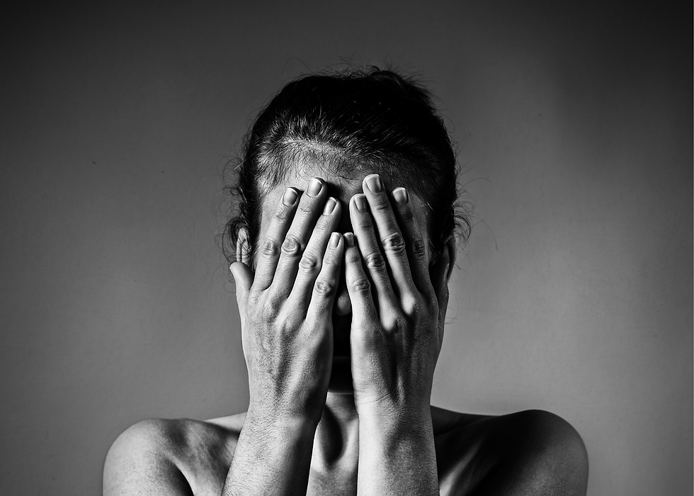 distressed woman with face in hands