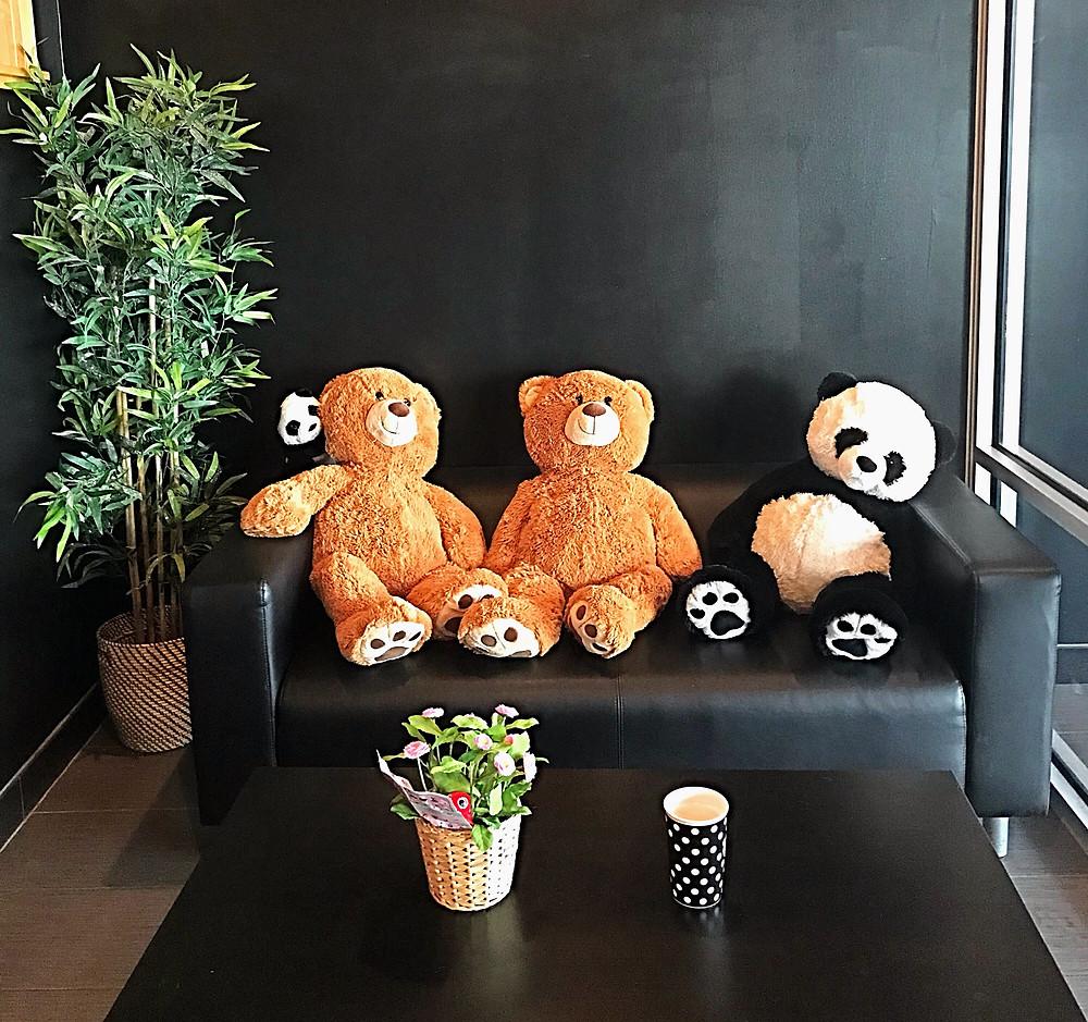stuffed bears on a bench