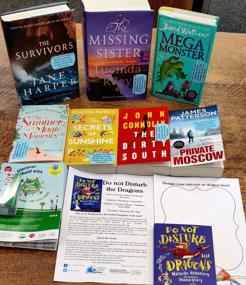 New books, Do Not Disturb the Dragons leaflets, Beat the Street leaflets - all displayed on a table in the library