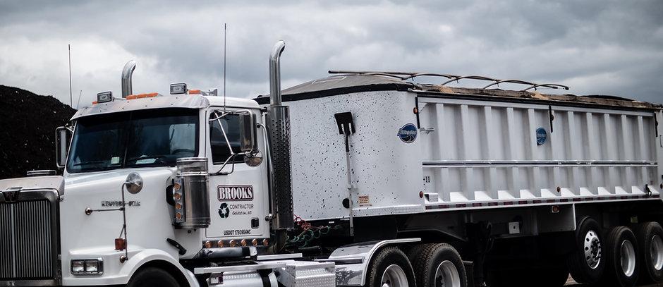 Brooks Contactor Hauling Truck