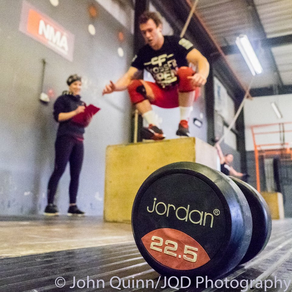 Rob Skinner of CrossFit Fareahm - having his tiebreaker time avidly noted by judge Emily Coglan.  CREDIT: John Quinn Photography