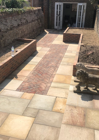 Pathed garden with brick surround bedding areas