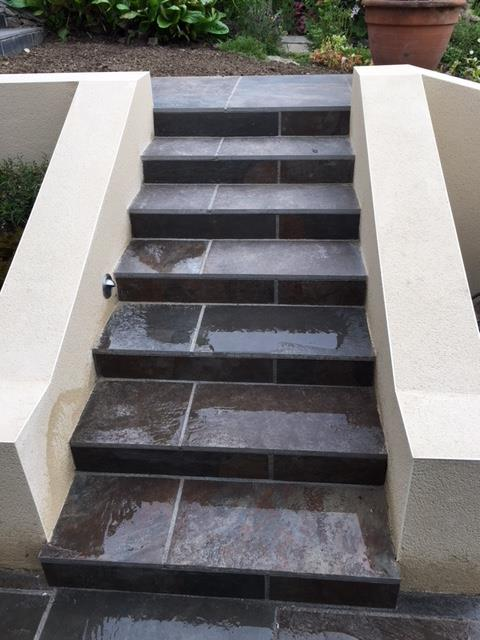 Modern steps leading to existing terrace