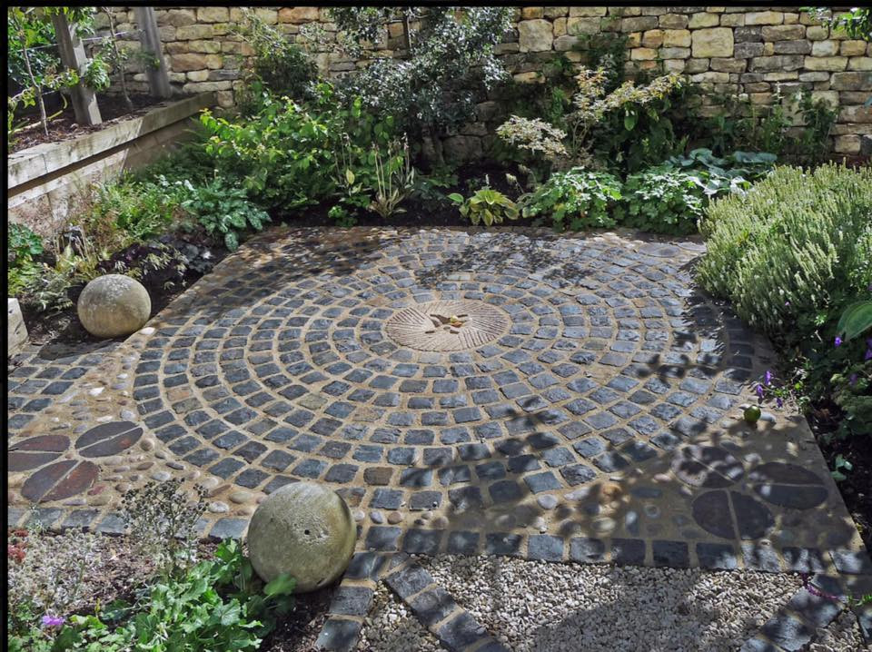 circular paving with stone mill centre a