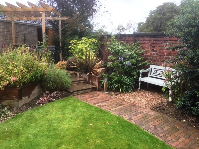 South Yorkshire, garden seat set amongst planting