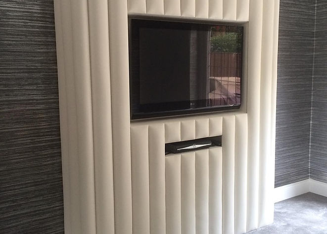 Fabric Wall Covering  behind Built in TV