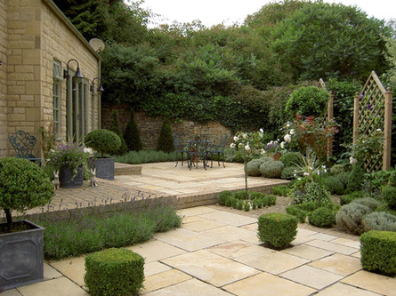 large paved courtyard style garden with