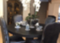 black dining room table and upholstered
