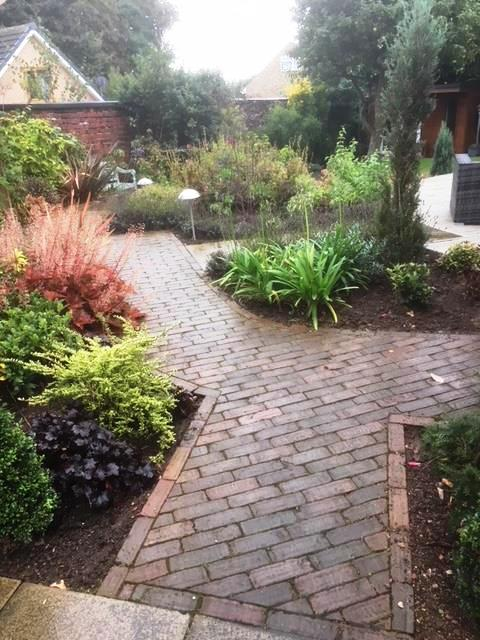 Interesting informal path through vibrant year round planting