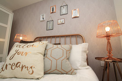 copper-bed-wallpaper-lamp-cushions-bedding-styling-showhome-complete