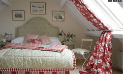 guest bedroom with cosy soft furnishings
