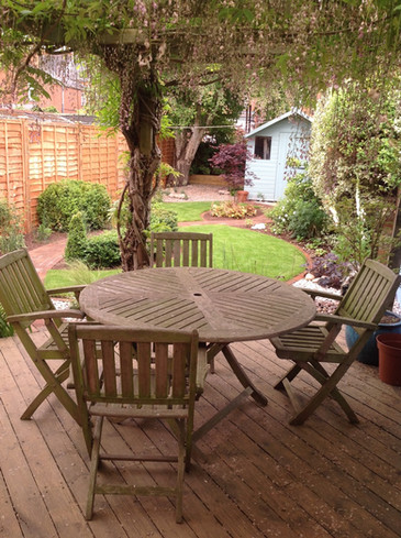 small town garden with decking area.jpeg