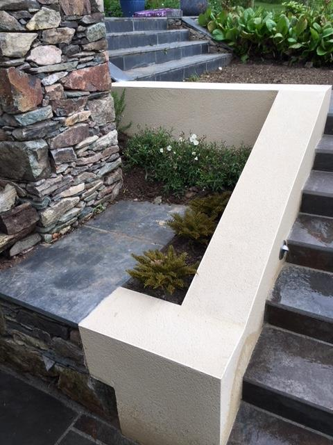 Modern steps and retainer connected to existing stone walling