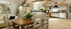 beamed country kitchen with cream stone flooring