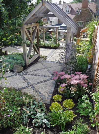 Wooden pergola and mixed stone paving.jp
