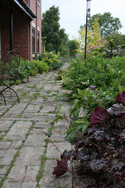 Informal paving and planting on old railway station