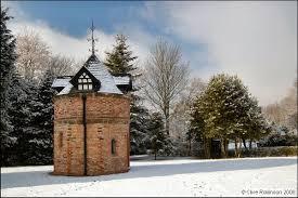 Dovecote in winter snow at Walkden Gardens (Sale Cheshire)