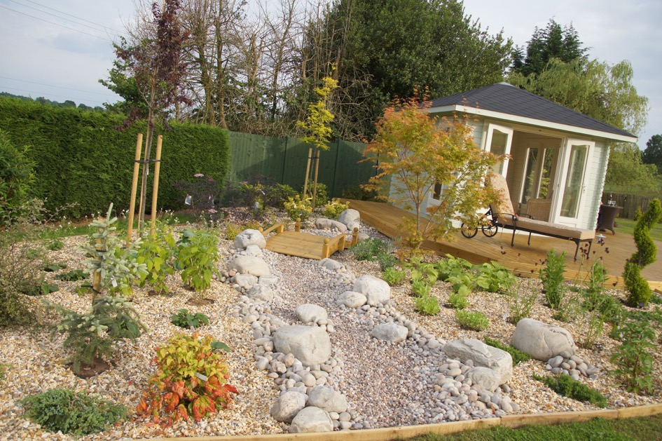 traditional garden - stones and summerho