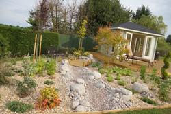 traditional garden - stones and summerho