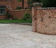 Large driveway paved in natural stone