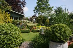 Garden office nestled amongst mixed planting