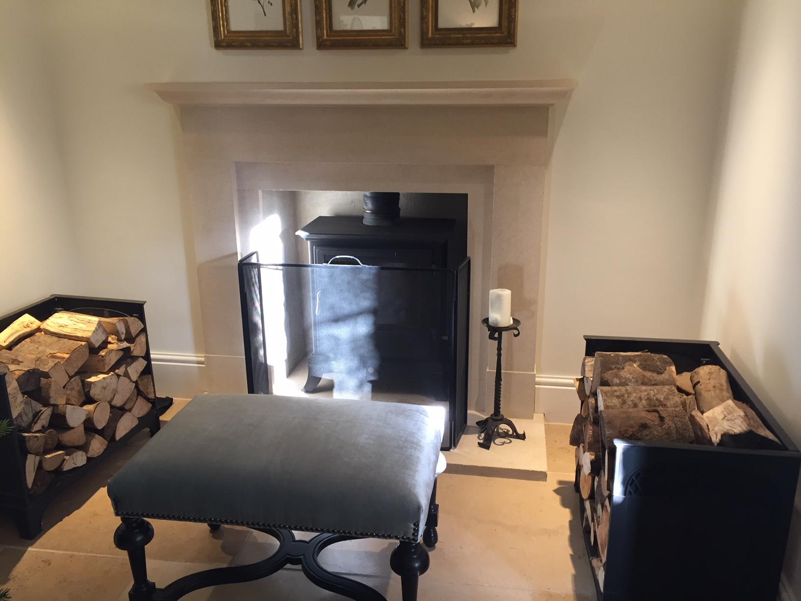 stone fireplace, firestool with custom-made log storage eitehr side