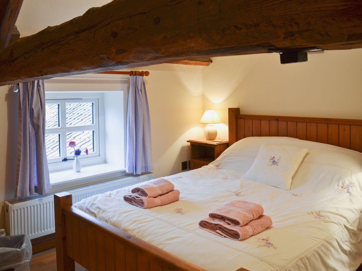 low-beamed Bedroom at Bridge Farm Holida