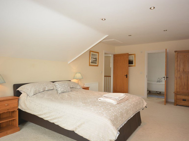 Master bedroom with ensuite and balcony