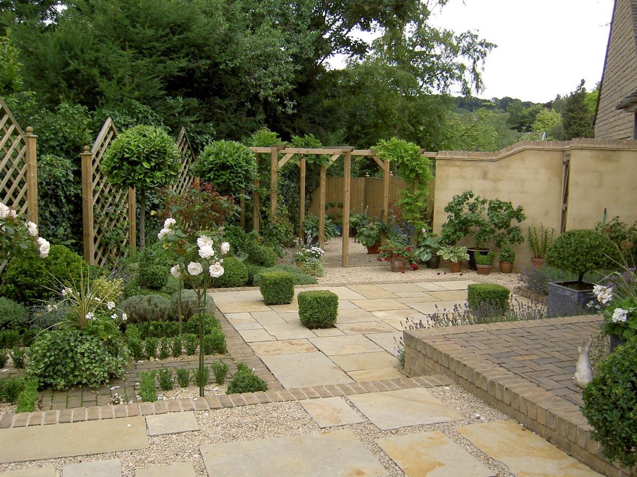 paving with topiary and pergolas.jpeg