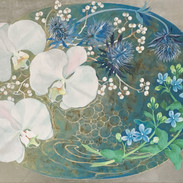 環の中の胡蝶蘭とブルースター