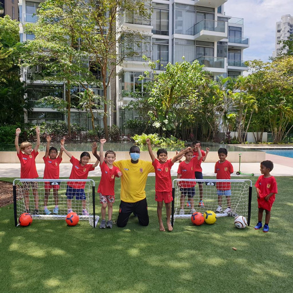 SG United Soccer Coach Gaye Alassane with the children